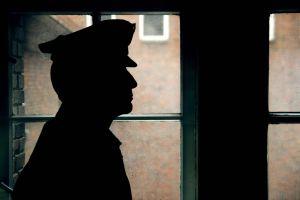 Silhouette of a prison/police warden