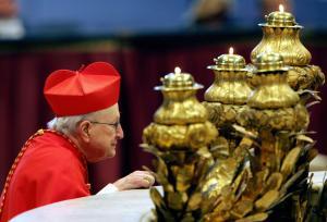 US Cardinal Edmund Casimir Szoka kneels